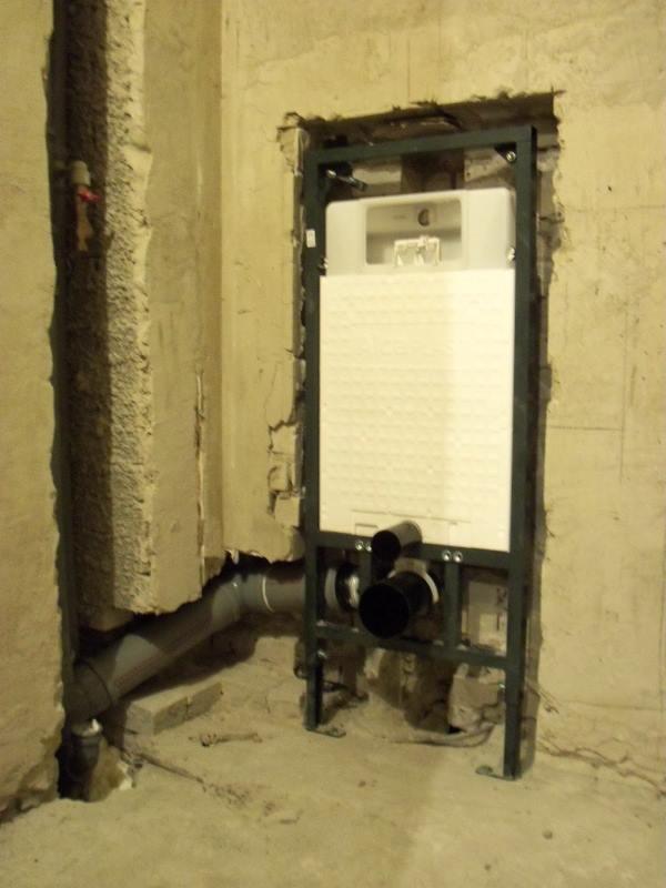 скрыть трубы канализации в стене квартиры