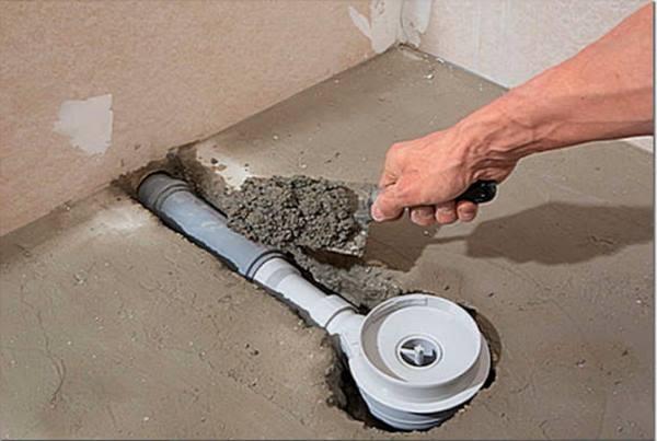 устройство слива в полу туалета